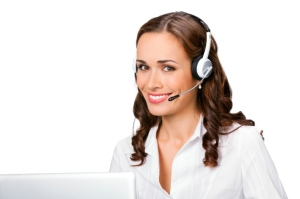 Young support phone operator in headset with laptop, isolated